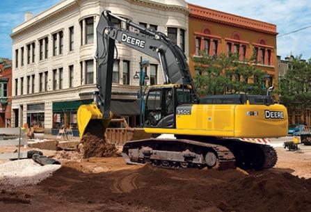 backhoe digging in a city